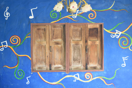 Grunge wooden window on blue music notes wall Imagens