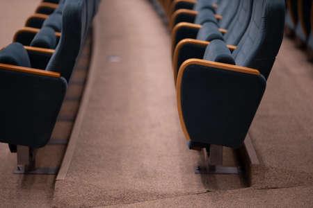 Gray velvet seats for spectators in the theater or cinema