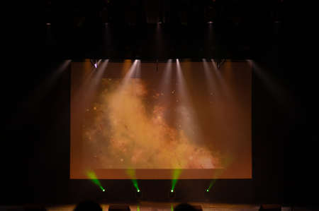 An empty stage of the theater, lit by spotlights and smoke before the performance Фото со стока