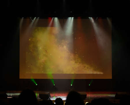 An empty stage of the theater, lit by spotlights and smoke before the performance Archivio Fotografico