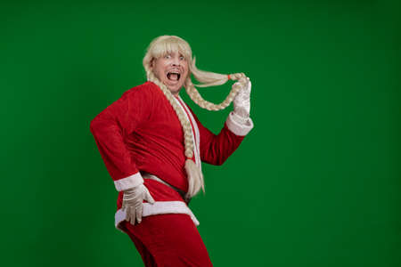 Emotional Santa Claus with long braid hairstyle grimaces and poses on a green chrome background