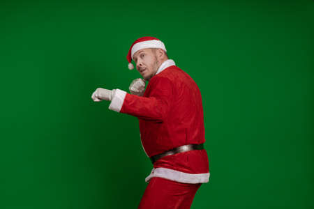 Emotional Santa Claus box and fights on a green chrome background Stock Photo