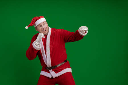 Emotional Santa Claus box and fights on a green chrome background Banco de Imagens