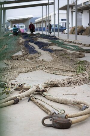 Fishing nets on the dock ready to be repaired