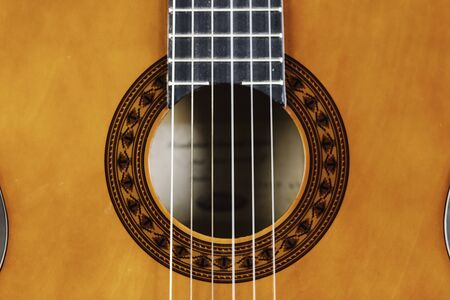 Spanish classical guitar, close-up Neck, mouth and strings of Spanish guitar