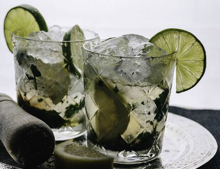 Close-up of cocktail with mojito ingredients and lots of crushed ice