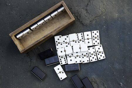 Domino game chips on dark background Foto de archivo