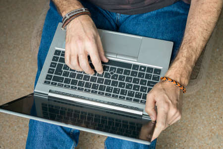 Man working with laptop from home