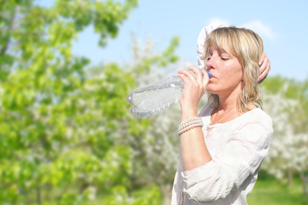 springwater: Woman drinking water from bottle Stock Photo