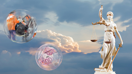 Justice figure in front of sky, glass sphere with accident and glass sphere with a lot of money as 16 to 9 Stock Photo