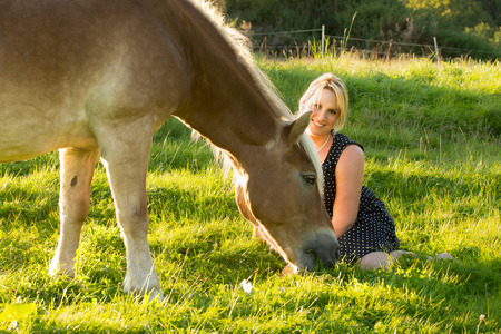 Romantic image of a woman with horse