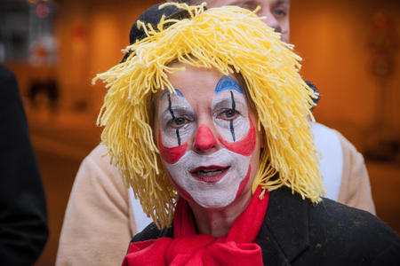 Cologne, Germany – March 14th 2014: A clown with yellow wig