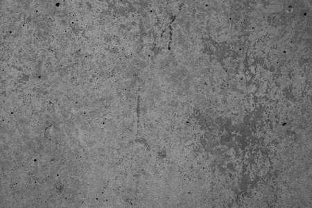 An area of coarse concrete in gray with a lot of texture fills the picture.
