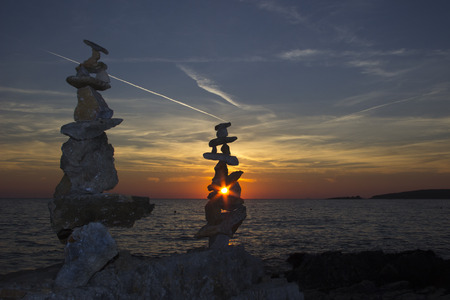 man made object: Totem of zen stones with beautifull sunset