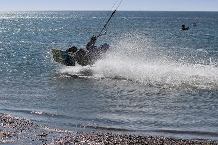 kiteboarding: Kitesurfer jump - in action