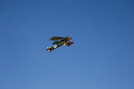 Old Military Plane flying on clear blue Sky