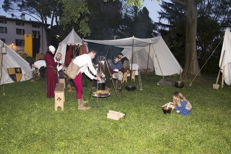 vestidos de epoca: Medieval People preparing Food on campfire in Medieval Camp