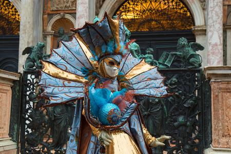 Woman Venetian Mask in colorful and elegant costume