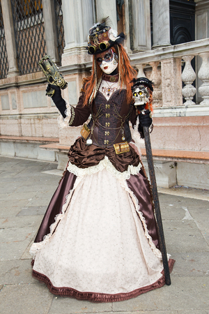 Female Venetian Mask with gun on St. Marks Square in Venice