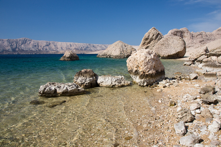 Island Pag, Beautiful sand beach with big rocks in the sea and turquise blue water - sea water background
