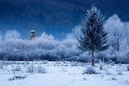 Hunting tower in cold winter