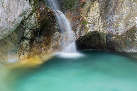 Beautiful green pool and waterfall of river Lepenca in Sunik water grove, Lepena valley, Bovec, Slovenia