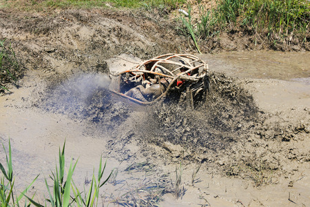 4x4 offroad race - 4wd car splashing mud and water with big tires