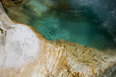 Beautiful green pool and waterfall of river Loska Koritnica, Log pod Mangrtom, Bovec, Slovenia, water background, turquoise, mountain river, stream, Soca valley, Triglav national park, Europe 写真素材