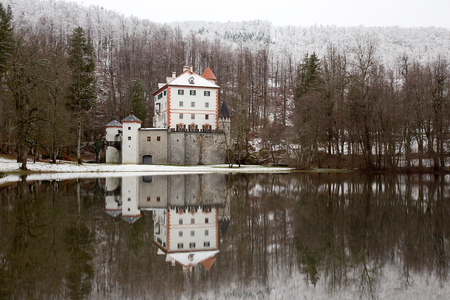 Winter idyllic landscape with reflection of castle Sneznik, Slovenia