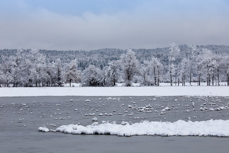 Winter landscape background with lake, ice and snow, Planina, Slovenia