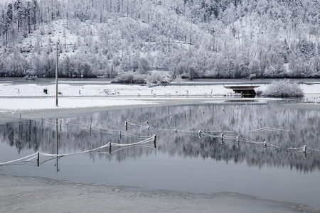 Flood - Winter water landscape with beautiful reflection in the water, Planina field, Slovenia