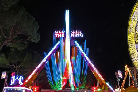 Ferris wheel with night Light Trails - Amusement park, Gorizia, Italy. 報道画像