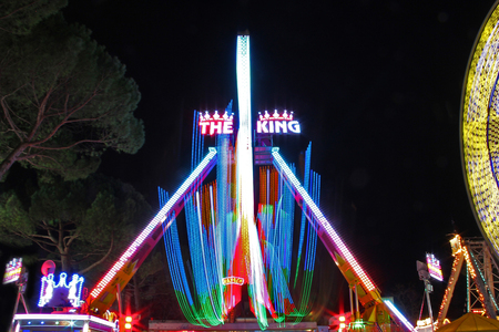 Ferris wheel with night Light Trails - Amusement park, Gorizia, Italy. Editorial