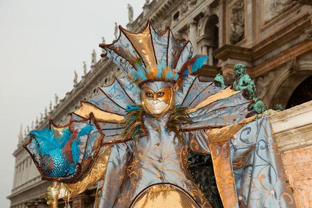 Venetian Mask in colorful and elegant costume -Venice Carnival