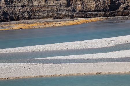 Diagonal line of river coast with low level of water, Empty accumulation lake, Most na Soci, Slovenia, water background