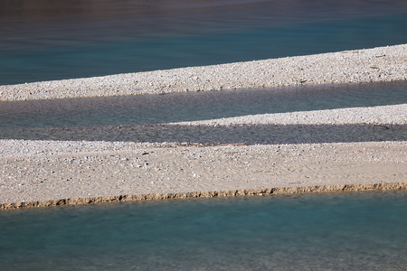 Diagonal line of river coast with turquoise river, Empty accumulation lake, Most na Soci, Slovenia, water background