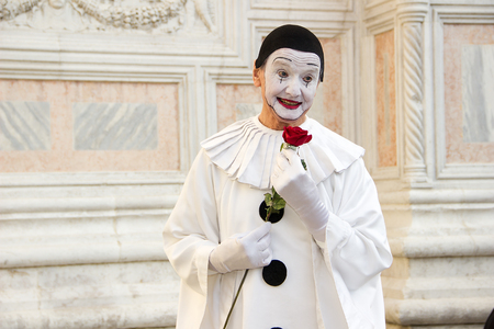 Pierrot Mask with Rose - man in Pierrot mask at Venice Carnival on San Zaccaria Square in Venice, Italy