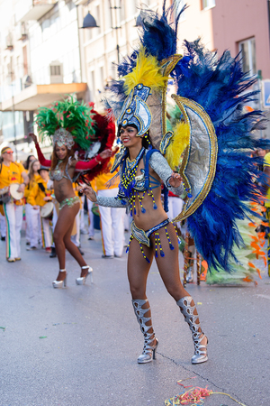 Brazil dancers dancing Samba on the streets of city carnival, Monfalcone, Italy