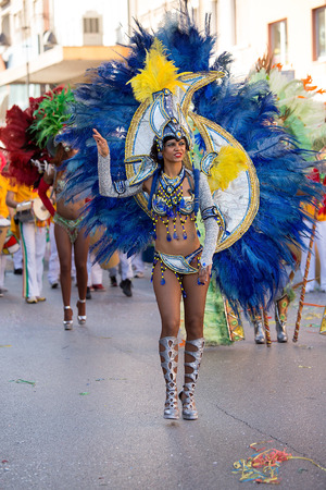 Beautiful Samba dancer in traditional brazil dancing costumes on the streets of city carnival, Monfalcone, Italy