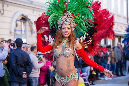 Beautiful Brazil Lady dancing Samba on the streets of city carnival, Monfalcone, Italy