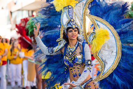 Beautiful Brazil Lady dancing Samba on the streets of city carnival, Monfalcone, Italy