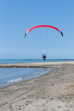 Paratrooper landing on the Grado beach Air show, Grado beach, Italy