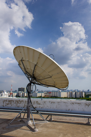 Satellite Dish for Telecommunications on rooftop photo