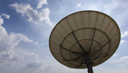 Satellite Dish for Telecommunications on blue sky background photo