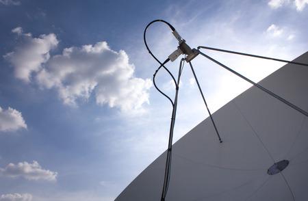 sattelite: Satellite Dish for Telecommunications on blue sky background
