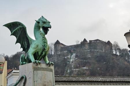 Ljubljana castle in the background of the Dragon bridge photo