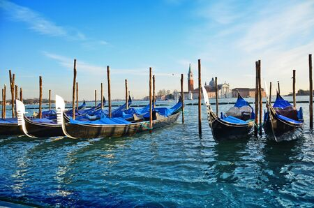 Gondolas and San Giorgio maggiore in Venice, view from San Marco square  photo