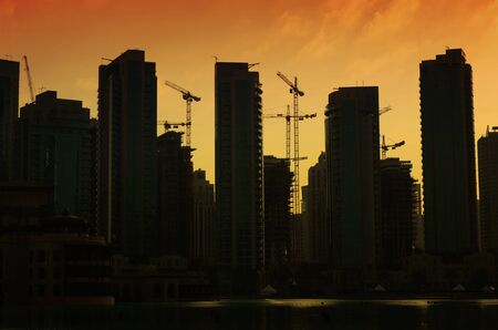 Silhouettes of buildings in Dubai at sunset
