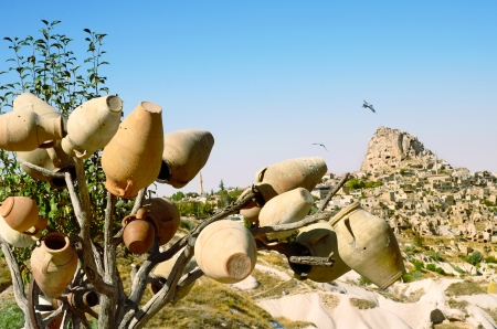 open air: Pottery  tree in front of Uchisar Castle in Cappadocia, Turkey Stock Photo