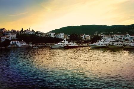 skiathos: Skiathos port at sunset Stock Photo